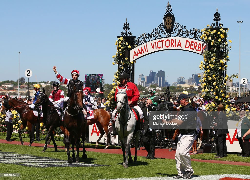 Hugh Bowman riding Polanksi returns to scale after winning race 6 the AAMI Victoria Derby during Derby Day at Flemington Racecourse on November 2, 2013 in Melbourne, Australia.