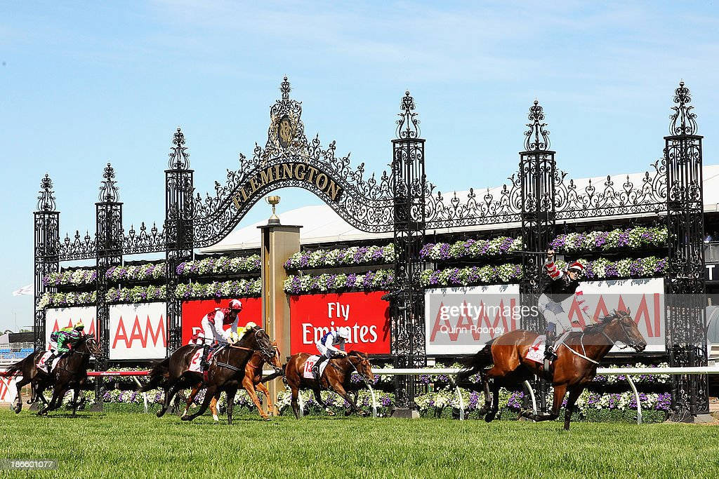 Hugh Bowman riding Polanski crosses the line to win race 6 the AAMI Victoria Derby during Derby Day at Flemington Racecourse on November 2 2013 in...