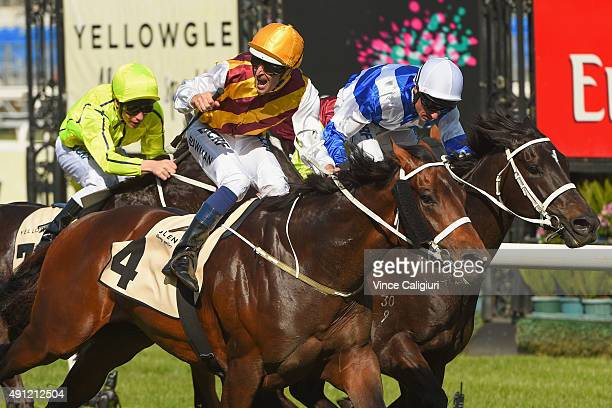 Hugh Bowman riding Preferment defeats Glen Boss riding Royal Descent in Race 7 the Yellowglen Turnball Stakes during Turnbull Stakes Day at...