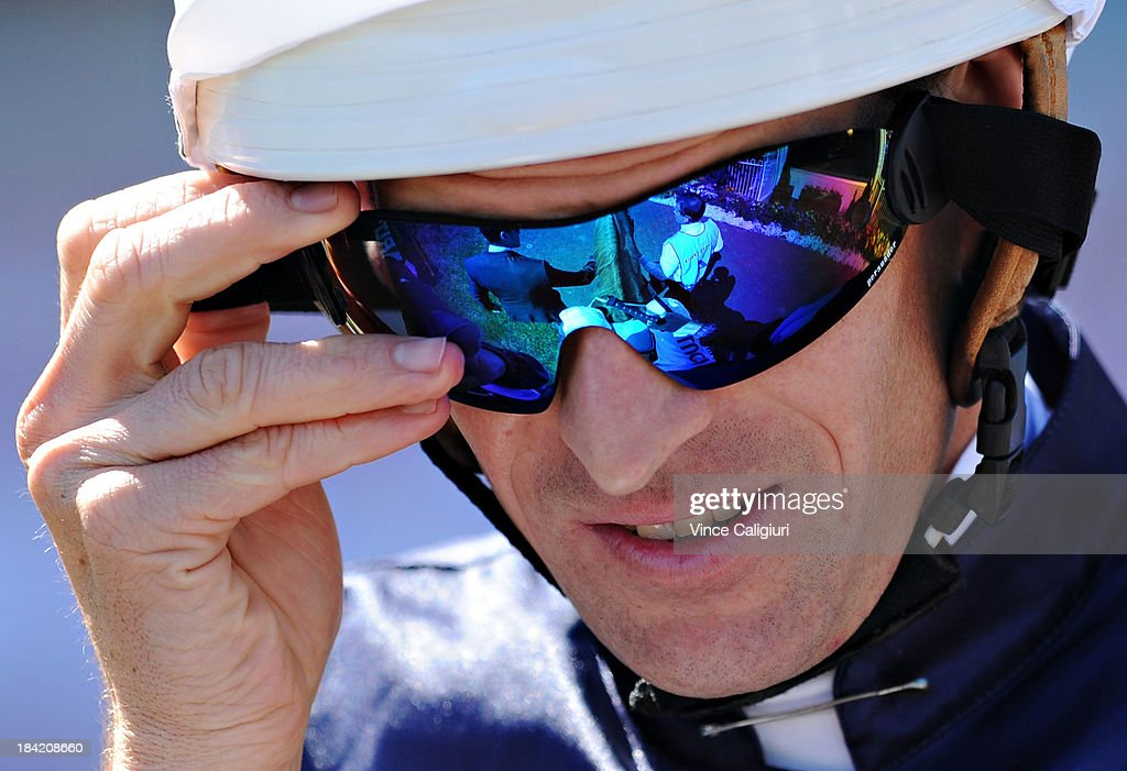 Hugh Bowman riding Sea Moon adjusts his goggles before winning the Sportingbet Herbert Power Stakes during Melbourne Racing at Caulfield Racecourse on October 12, 2013 in Melbourne, Australia.