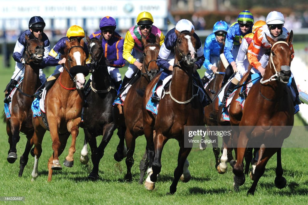 Hugh Bowman riding Sea Moon (ctr) turns out of the straight with one lap remaining before winning the Sportingbet Herbert Power Stakes during Melbourne Racing at Caulfield Racecourse on October 12, 2013 in Melbourne, Australia.