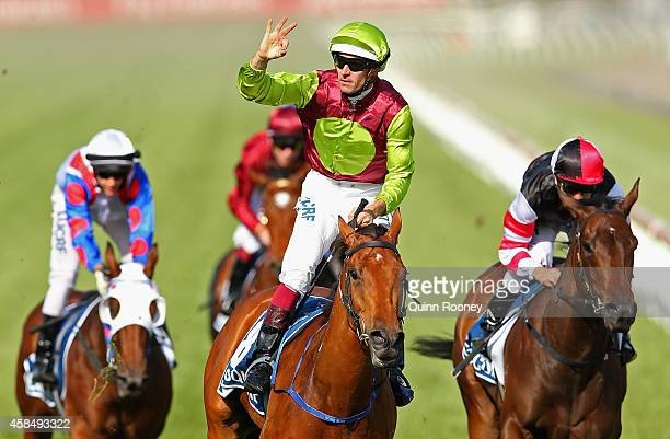 Hugh Bowman riding Set Square celebrates as he crosses the line to win race 8 the Crown Oaks on Oaks Day at Flemington Racecourse on November 6 2014...