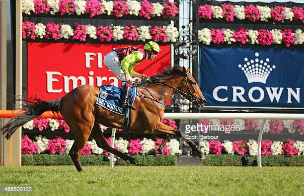 Hugh Bowman riding Set Square crosses the line to win race 8 the Crown Oaks on Oaks Day at Flemington Racecourse on November 6 2014 in Melbourne...