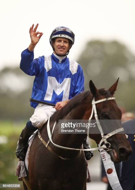 Hugh Bowman riding 'Winx' celebrates after winning Race 5 China Horse Club George Ryder during 2017 Golden Slipper Day at Rosehill Gardens on March...