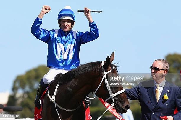 Hugh Bowman riding Winx celebrates winning Race 5 in The China Horse Club George Ryder Stakes during Golden Slipper Day at Rosehill Gardens on March...