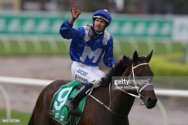 Hugh Bowman riding Winx celebrates winning the Chipping Norton Stakes at Royal Randwick Racecourse on February 25 2017 in Sydney Australia