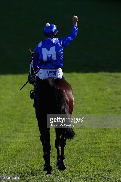 Hugh Bowman riding 'Winx' celebrates winning The Longines Queen Elizabeth Stakes during The Championships Day 2 at Royal Randwick Racecourse on April...