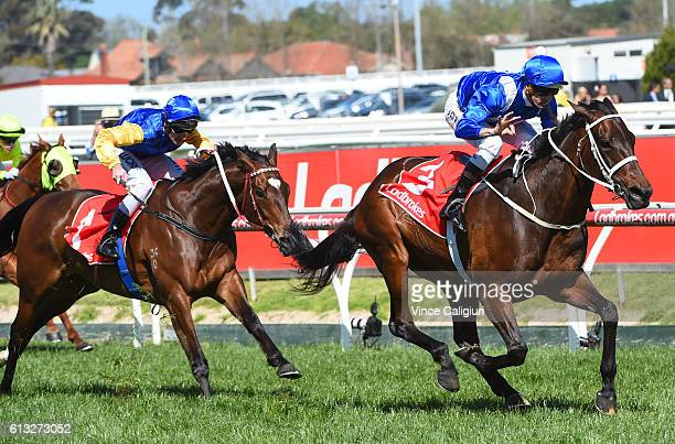 Hugh Bowman riding Winx defeats Brad Rawiller riding Black Heart Bart and Craig Williams riding He or She in Race 6 Ladbrokes Caulfield Stakes during...