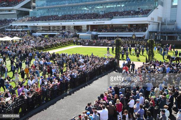 Hugh Bowman riding Winx in front of huge crowd before winning Race 5 Turnbull Stakes during Turnbull Stakes day at Flemington Racecourse on October 7...