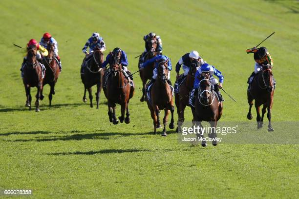 Hugh Bowman riding 'Winx' leads the field in The Longines Queen Elizabeth Stakes during The Championships Day 2 at Royal Randwick Racecourse on April...