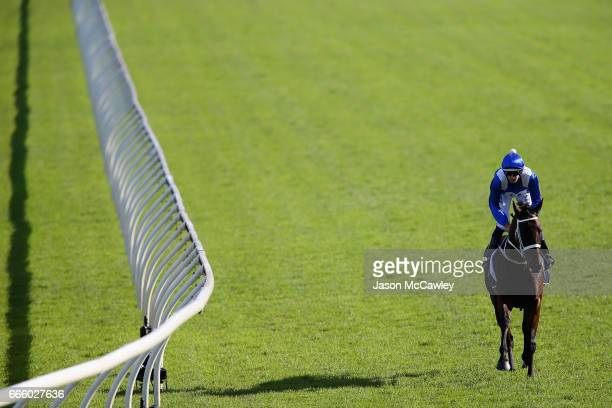 Hugh Bowman riding 'Winx' make their way to the barriers prior to The Longines Queen Elizabeth Stakes during The Championships Day 2 at Royal...