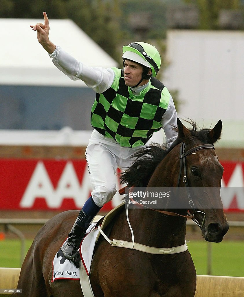 Hugh Bowman salutes the crowd after winning the Cathay Pacific George Ryder Stakes on Courts In Session during the Golden Slipper Race Day at...