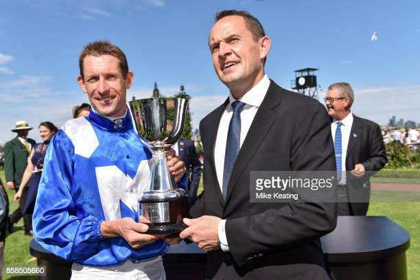 Hugh Bowman with Chris Waller after Winx won the Seppelt Turnbull Stakes at Flemington Racecourse on October 07 2017 in Flemington Australia