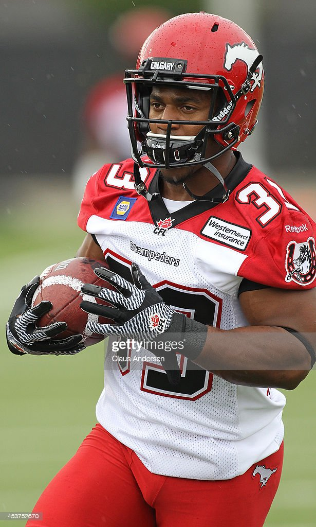 Hugh Charles of the Calgary Stampders warms up prior to play against the Hamilton TigerCats in a CFL game at Ron Joyce Stadium on August 16 2014 in...