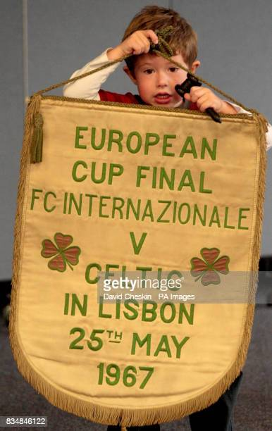 Hugh Convery helps out at the preview before the auction of the official Celtic FC pennant from the 1967 European Cup Final
