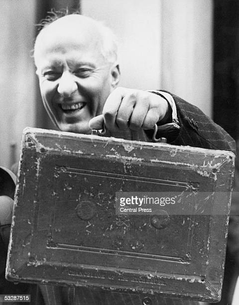 Hugh Dalton British Chancellor of the Exchequer leaves Number 11 Downing Street for the House of Commons carrying the budget box 9th April 1946