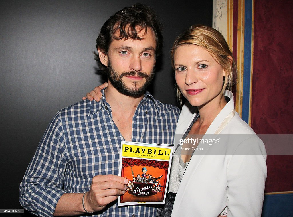 Hugh Dancy and wife Claire Danes pose backstage at 'A Gentleman's Guide To Love and Murder' on Broadway at The Walter Kerr Theater on May 27, 2014 in New York City.