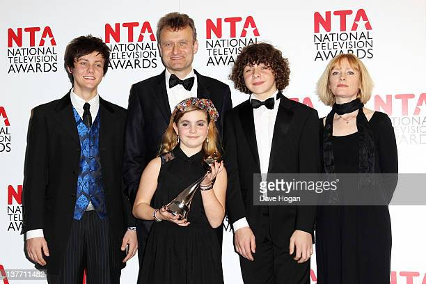 Hugh Dennis Tyger Drew Honey Ramona Marquez Daniel Roache and Claire Skinner of Outnumbered pose with their Situation Comedy Award in the press room...