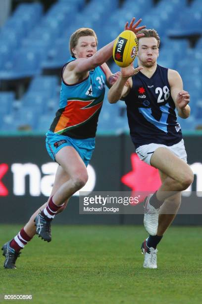 Hugh DIXON of the Allies and Noah Balta of Vic Metro compete for the bal during the U18 AFL Championships match between Vic Metro and the Allies at...