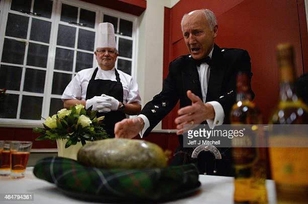Hugh Farrell addresses the haggis at a Burns supper in the red room at Burns Cottage Pavilion on January 23 2014 in Alloway Scotland People around...