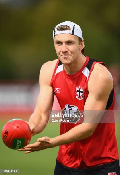 Hugh Goddard of the Saints handballs during a St Kilda Saints AFL training session at Linen House Oval on March 20 2017 in Melbourne Australia