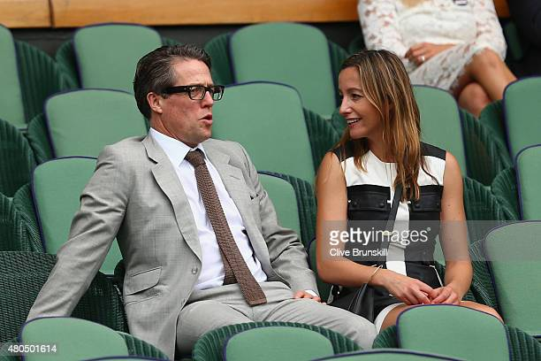 Hugh Grant and Anna Eberstein attend day thirteen of the Wimbledon Lawn Tennis Championships at the All England Lawn Tennis and Croquet Club on July...