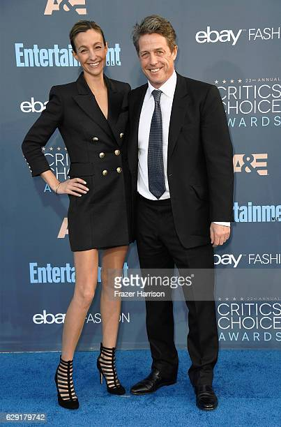 Hugh Grant and Anna Elisabet Eberstein attend The 22nd Annual Critics' Choice Awards at Barker Hangar on December 11 2016 in Santa Monica California
