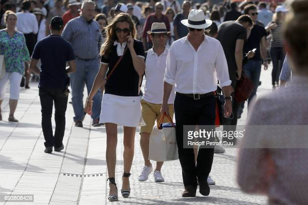 Hugh Grant and his wife Anna are spotted at Roland Garros on June 8 2017 in Paris France