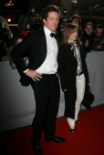 Hugh Grant and Isabelle Huppert during 2006 Cesar Awards Ceremony Arrivals at Theatre du Chatelet in Paris France