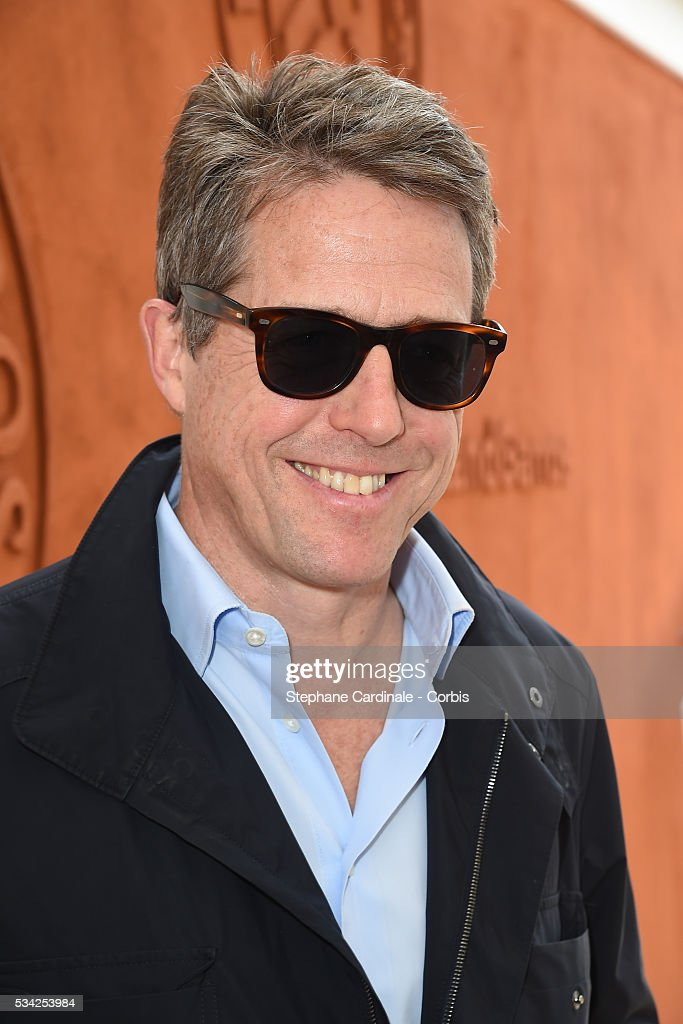 Hugh Grant attend the day four of the 2016 French Open at Roland Garros on May 25, 2016 in Paris, France.