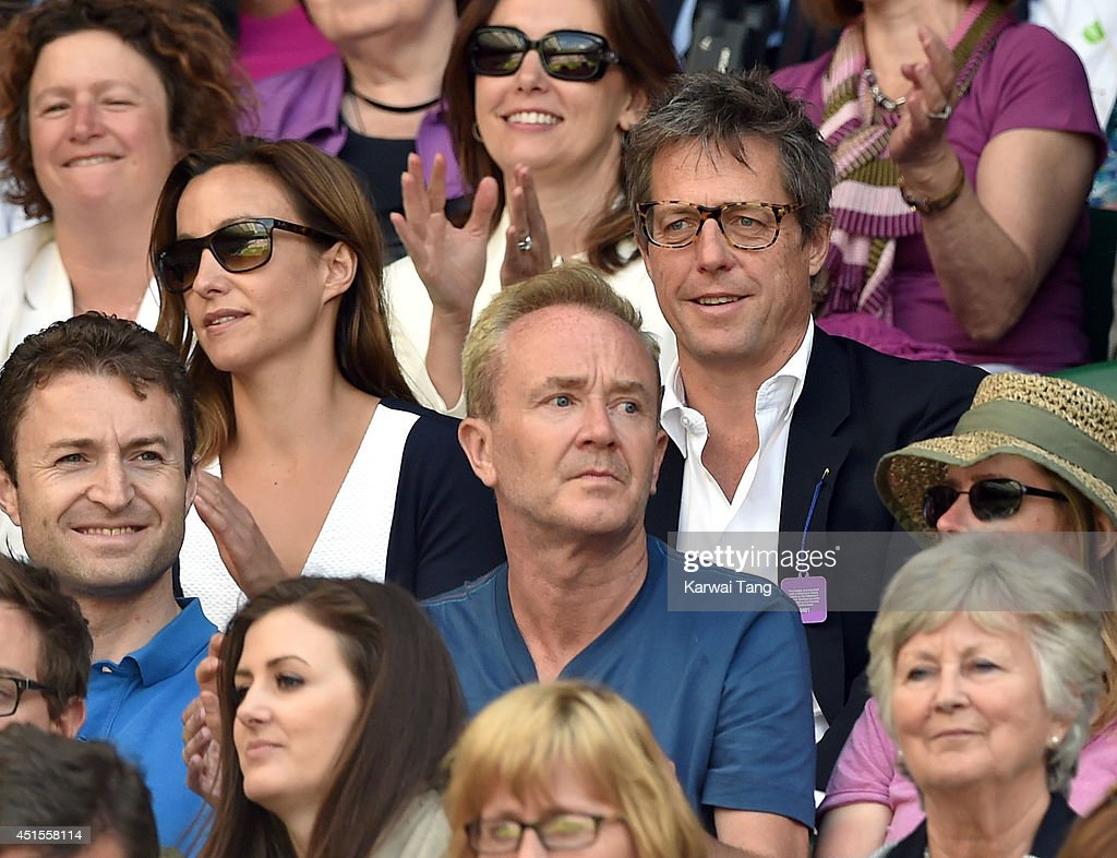Hugh Grant attends the Nick Kyrgios v Rafael Nadal match on centre court during day eight of the Wimbledon Championships at Wimbledon on July 1, 2014 in London, England.