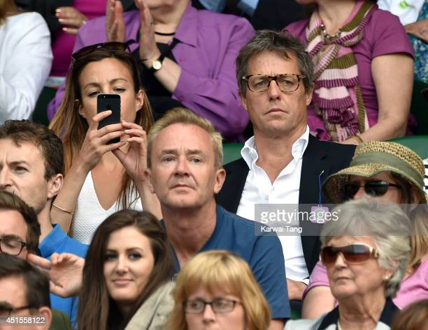 Hugh Grant attends the Nick Kyrgios v Rafael Nadal match on centre court during day eight of the Wimbledon Championships at Wimbledon on July 1 2014...