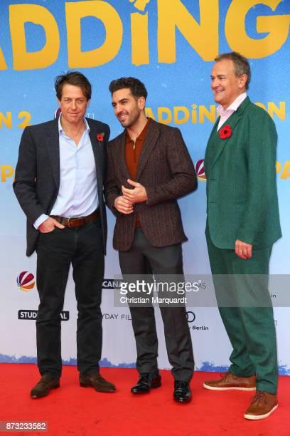 Hugh Grant Elyas M' Barek and Hugh Bonneville attend the 'Paddington 2' premiere at Zoo Palast on November 12 2017 in Berlin Germany