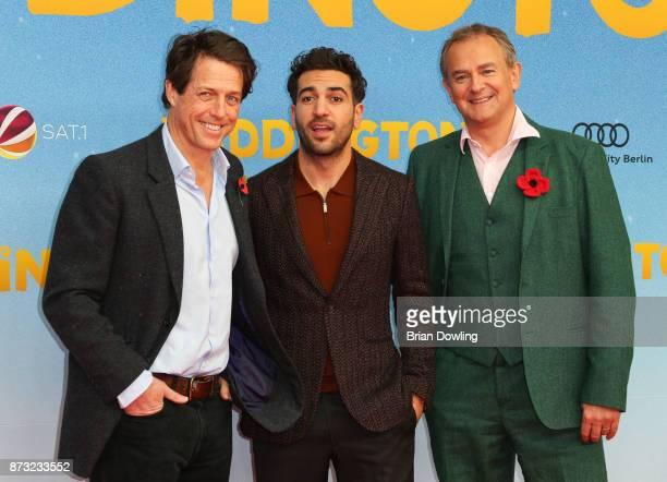 Hugh Grant Elyas M'Barek and Hugh Bonneville attends the 'Paddington 2' premiere at Zoo Palast on November 12 2017 in Berlin Germany
