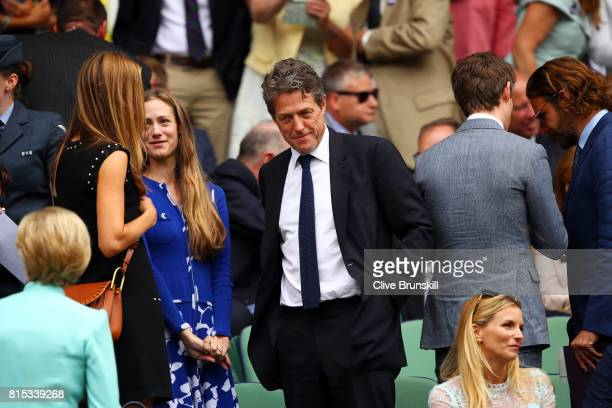 Hugh Grant looks on from the centre court royal box prior to the Gentlemen's Singles final between Roger Federer of Switzerland and Marin Cilic of...