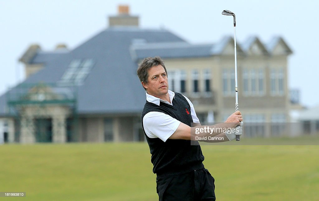 Hugh Grant of England the film star plays his second shot at the par 4, 10th hole during the second round of the 2013 Alfred Dunhill Links Championship at the Kingsbarns Golf Links on September 27, 2013 in Kingsbarns, Scotland.