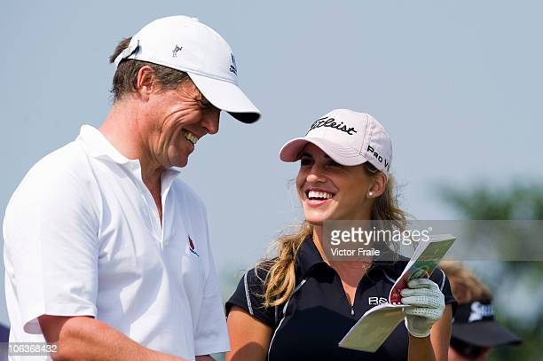Hugh Grant of Great Britain and Spanish golfer Belen Mozo laugh on the 11th tee during day four of the Mission Hills Start Trophy tournament at...