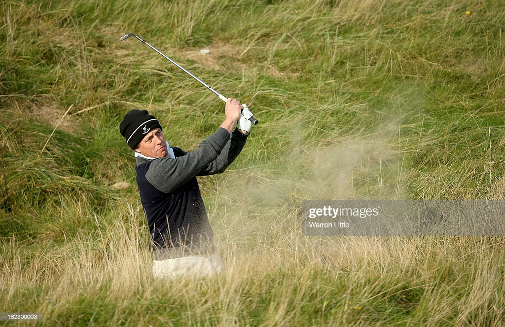 Hugh Grant plays out from the bunker on the 17th hole during the final round of the Alfred Dunhill Links Championship on The Old Course, at St Andrews on September 29, 2013 in St Andrews, Scotland.