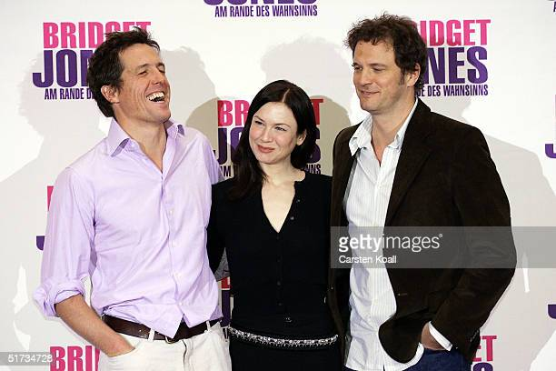 Hugh Grant Renee Zellweger and Colin Firth pose at the photocall to promote 'Bridget Jones The Edge of Reason' at Hotel Adlon on November 11 2004 in...