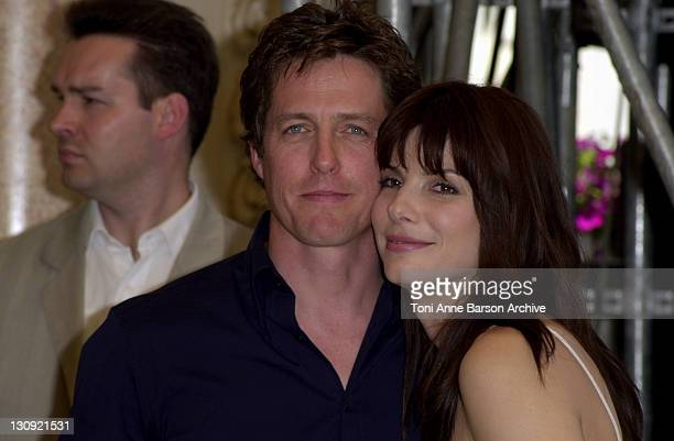 Hugh Grant Sandra Bullock during Cannes 2002 'Two Weeks Notice' Photo Call in Cannes France