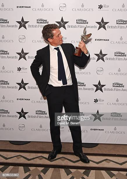 Hugh Grant winner of the Best Actor award for 'Florence Foster Jenkins' poses at The London Evening Standard British Film Awards at Claridge's Hotel...