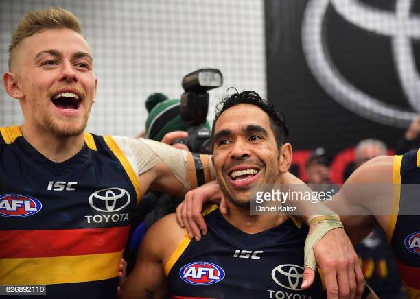 Hugh Greenwood and Eddie Betts of the Crows sing the club song after during the round 20 AFL match between the Adelaide Crows and the Port Adelaide...