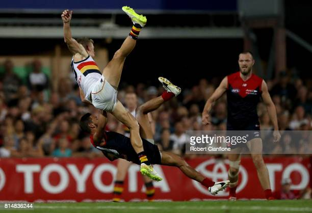 Hugh Greenwood of the Crows and Neville Jetta of the Demons collide during the round 17 AFL match between the Melbourne Demons and the Adelaide Crows...