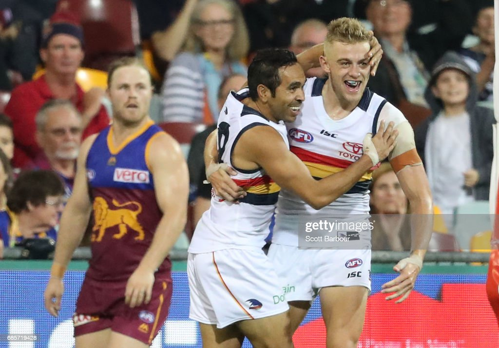 Hugh Greenwood of the Crows is congratulated by Eddie Betts of the Crows after kicking his second goal during the round nine AFL match between the Brisbane Lions and the Adelaide Crows at The Gabba on May 20, 2017 in Brisbane, Australia.