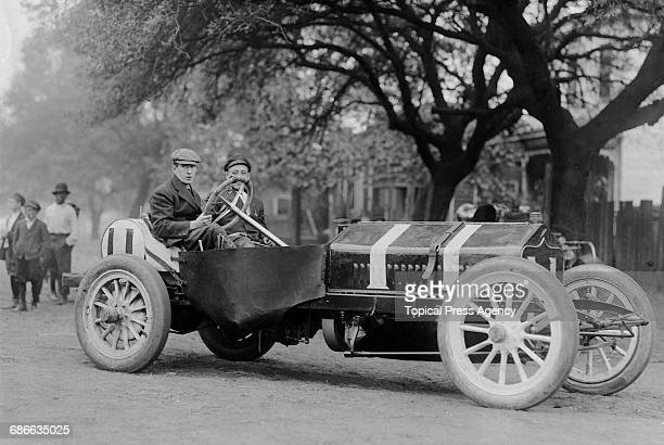 Hugh Harding of the United States with his riding mechanic aboard the National during the Grand Prize of the Automobile Club of America races on 26...