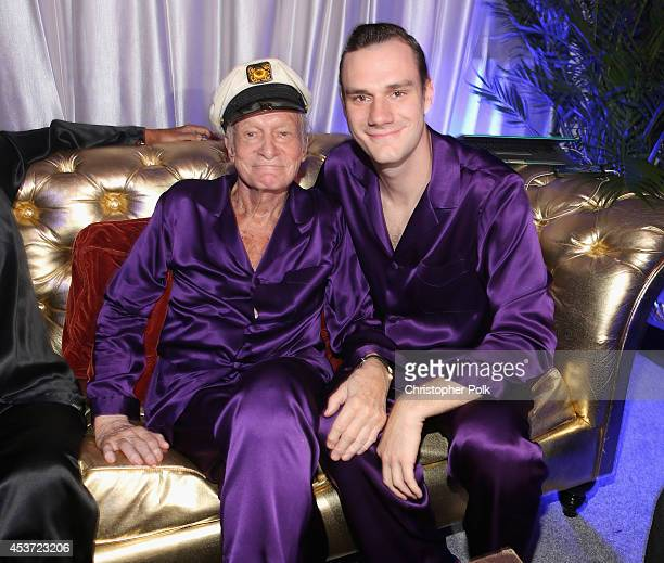 Hugh Hefner and Cooper Hefner attend the Annual Midsummer Night's Dream Party at the Playboy Mansion hosted by Hugh Hefner on August 16 2014 in...