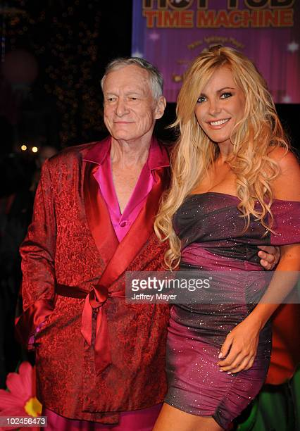 Hugh Hefner and Crystal Harris arrive at the Kandyland V Benefit and Hot Tub Time Machine Blu ray DVD Launch at The Playboy Mansion on June 26 2010...