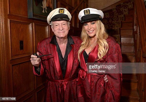 Hugh Hefner and Crystal Hefner attend Playboy Mansion's Annual Halloween Bash at The Playboy Mansion on October 25 2014 in Los Angeles California