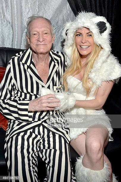 Hugh Hefner and model Crystal Hefner attend the annual Halloween Party hosted by Playboy and Hugh Hefner at the Playboy Mansion on October 24 2015 in...
