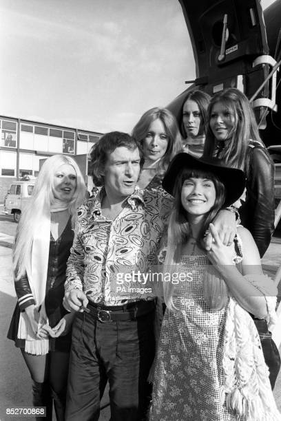 Hugh Hefner boss of the Playboy Empire and the bunnies on arrival here yesterday with his girl friend Barbi Benton He has come to Europe to attend...